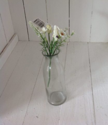 milk bottle with white flower spray