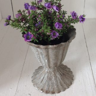 Antiqued pot with purple flowers