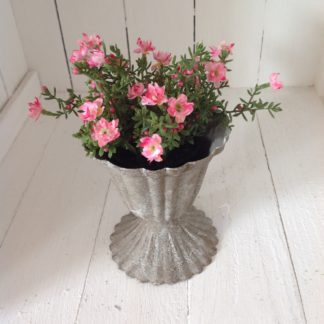 Antiqued pot with pink flowers