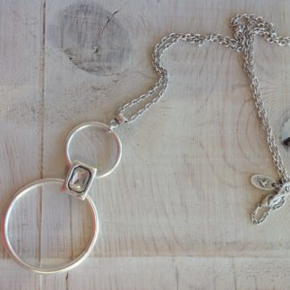 Long necklace with circular charms and a gem insert