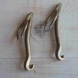 Antique brass bottle opener